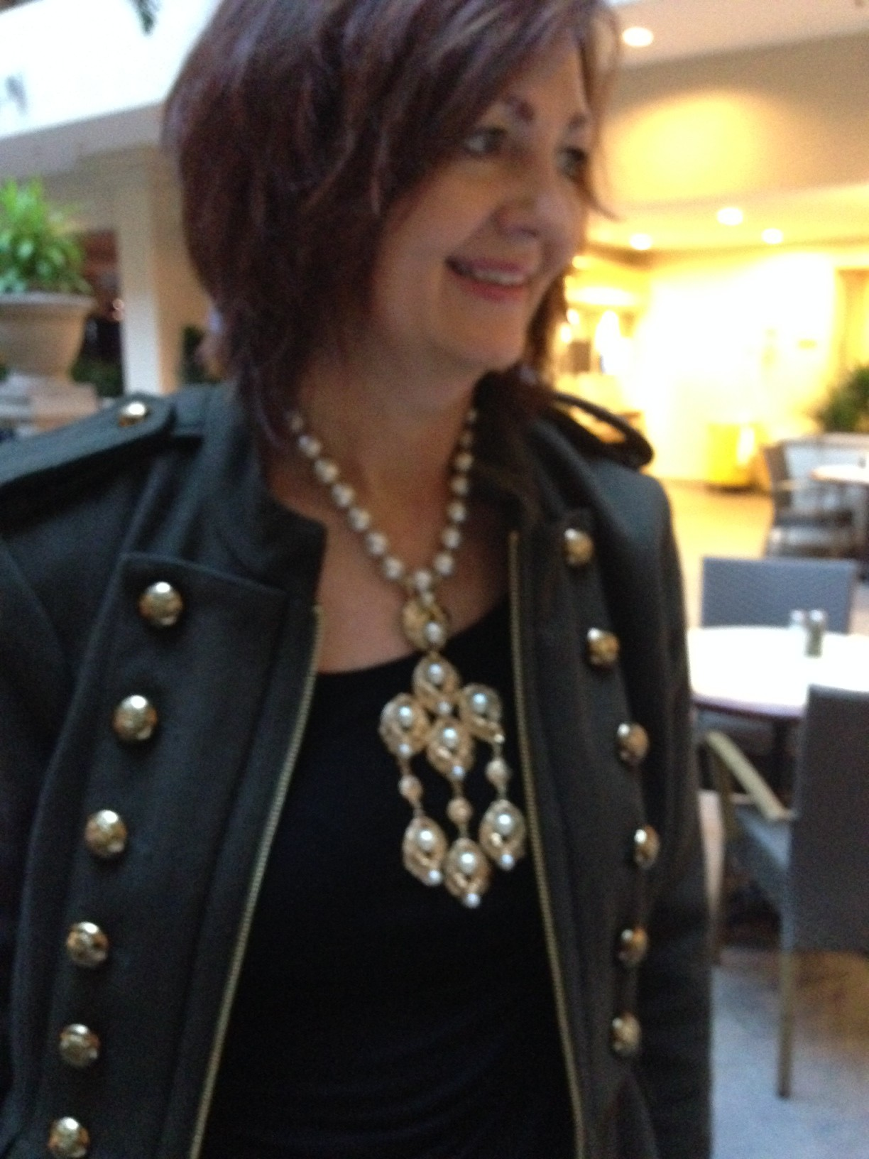 A necklace plays with a jacket
